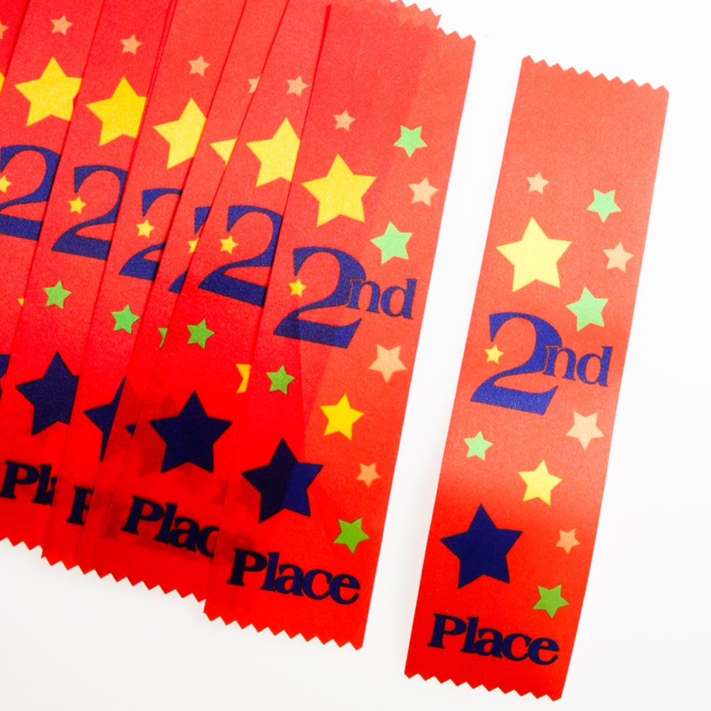 "Reward a Job Well Done. Reward your superstars with ""2nd Place"" Award Ribbons for a job well done. From sporting events to academia, award those who have put their all into the task at hand. These red ribbons are a great way to show appreciation while staying within your budget. 12 ribbons per package. Award ribbons are approximately 1 3/4 x 7 3/4. Make all of your participants winners with unique trophies, ribbons, and medals. Appreciate your contributors and players with awards they will be proud to display!"